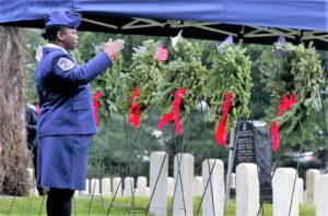 A military representative adorns the branch wreath